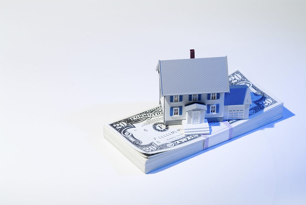 Toy House and Stack of Twenties